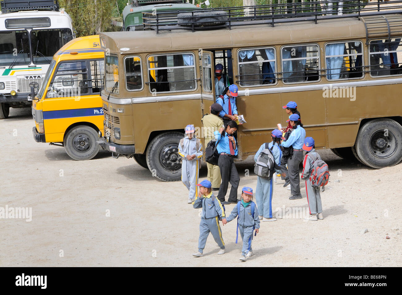 Elementary school students in school uniform coming from a school bus of the Indian army, Secondary Senior School, - Stock Image