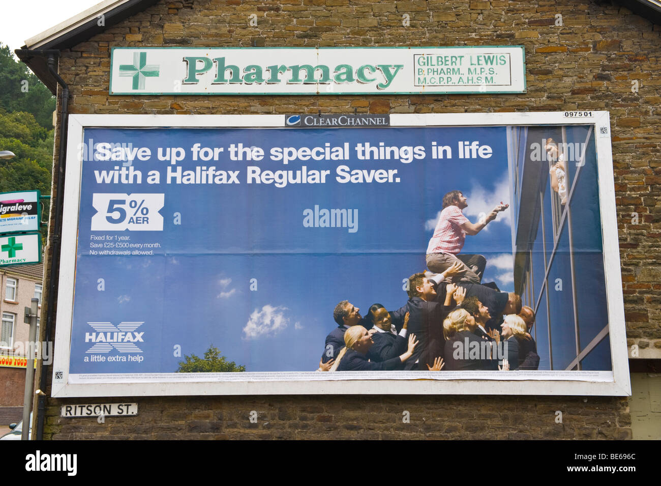 ClearChannel billboard for Halifax Regular Saver on end wall of chemist shop Briton Ferry near Neath South Wales - Stock Image