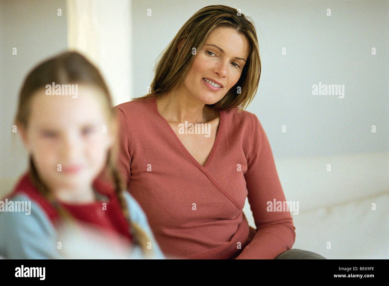 Mother looking at daughter with pride - Stock Image