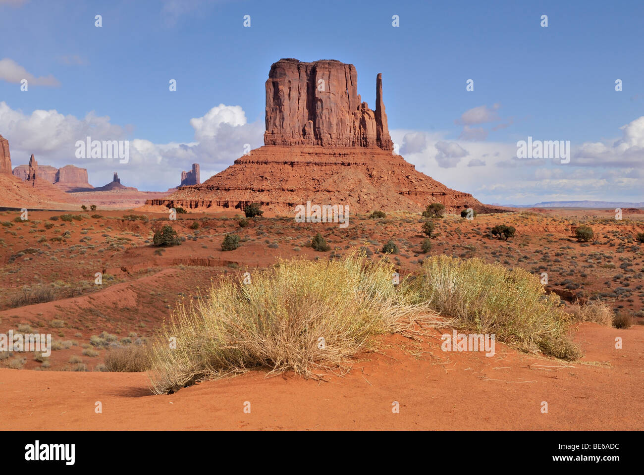 West Mitten Butte, multi-layered red sandstone, Monument Valley Navajo Nation Park, Arizona, USA - Stock Image