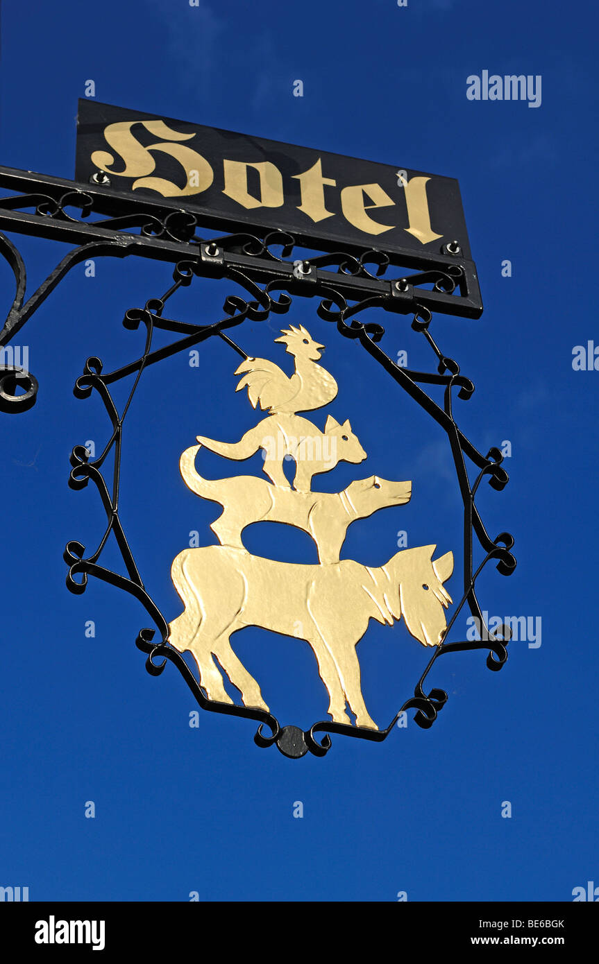 Hotel sign 'The Bremen Town Musicians' at Hotel Bremer Hof against blue sky, Lueneburg, Lower Saxony, Germany, - Stock Image