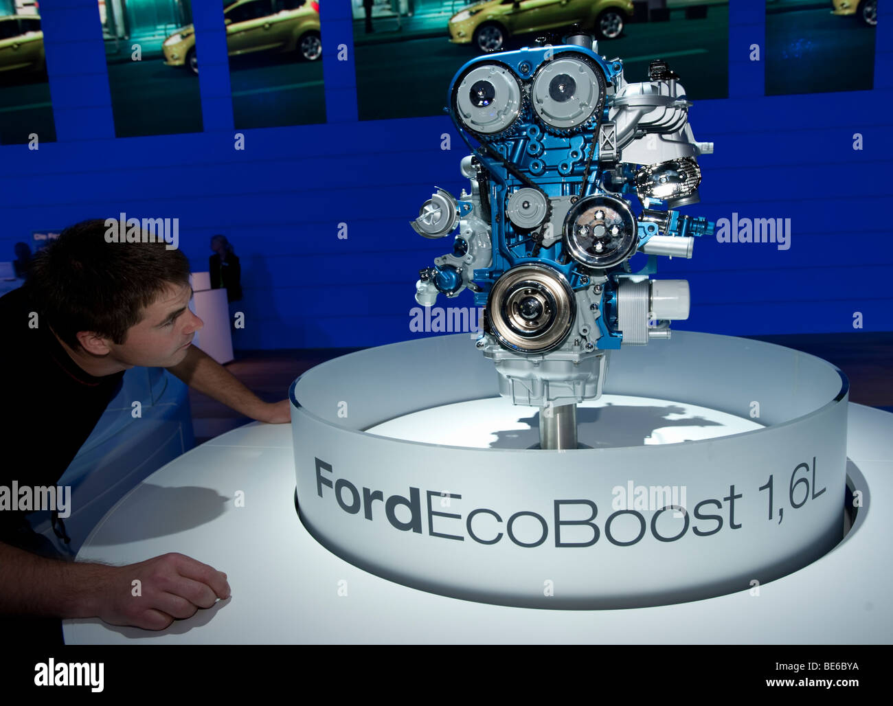 Man examines new efficient Eco Boost engine from Ford at the Frankfurt Motor Show 2009 - Stock Image