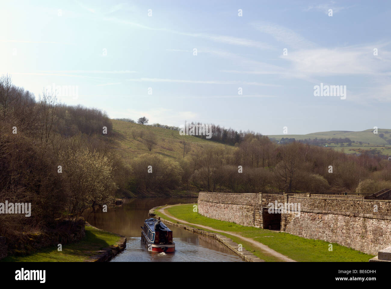 Longboat travelling on the' Peak Forest Canal' at Bugsworth - Stock Image