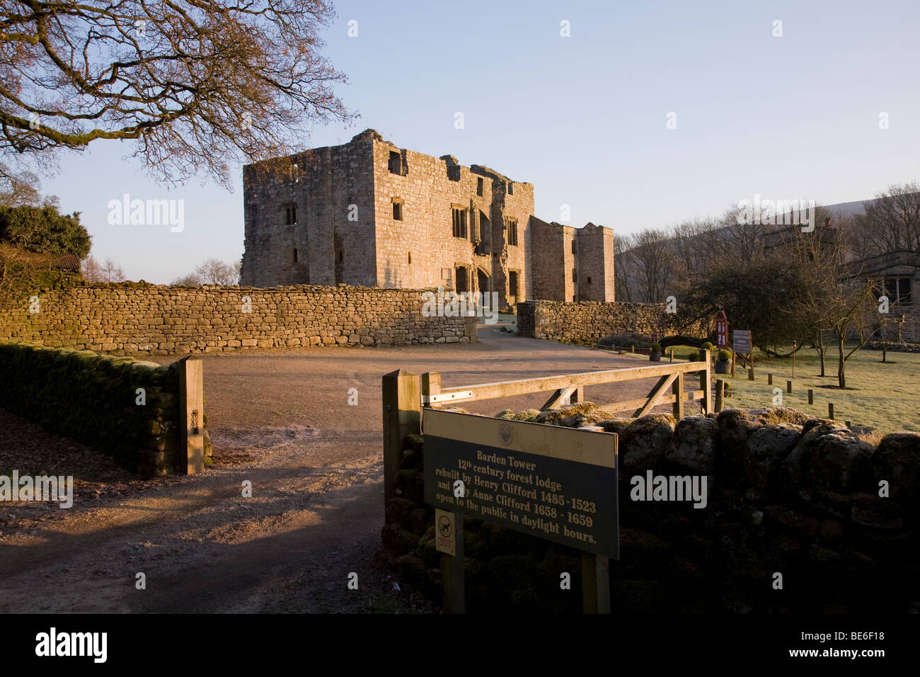 Barden Tower (sunlight on beautiful historic ancient ruin & information sign at entrance gate) - Bolton Abbey Estate, Yorkshire Dales, England UK. Stock Photo