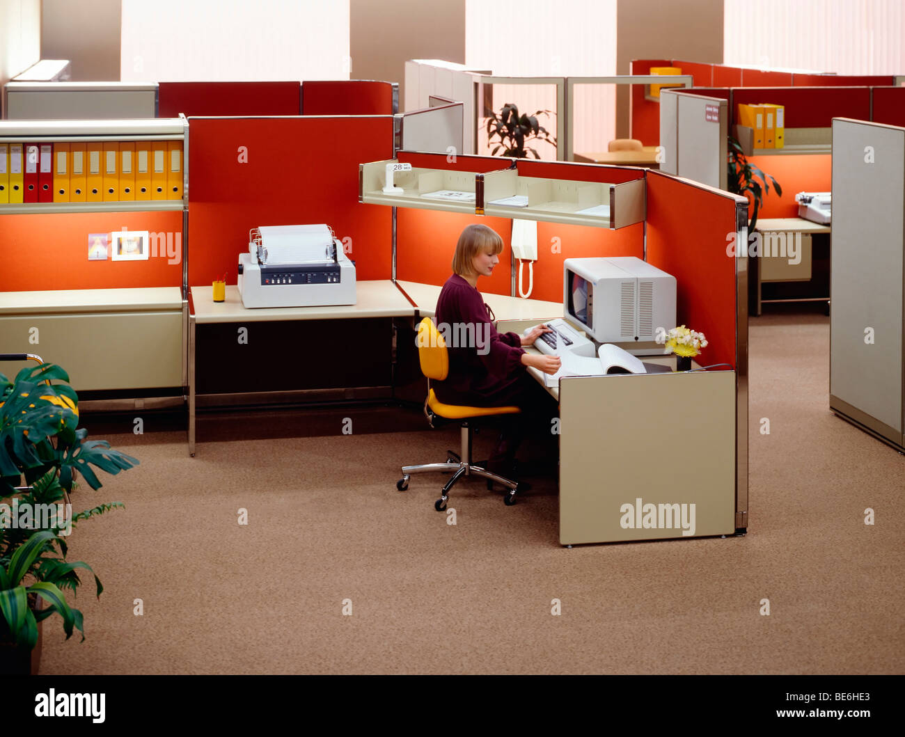 1980s Open Space Office With Woman At Computer Stock Photo