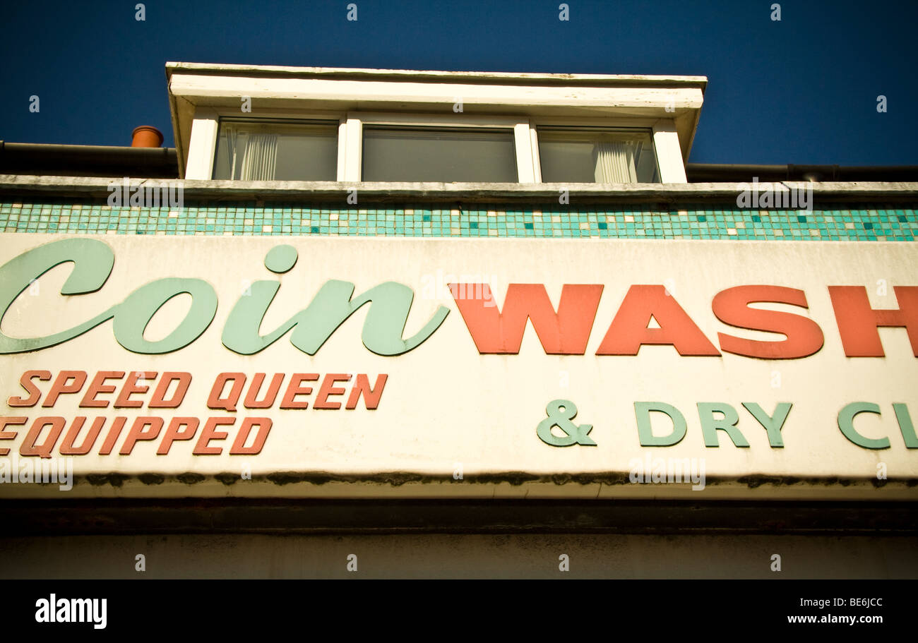 Coin Wash launderette and dry clean abstract sign - Stock Image
