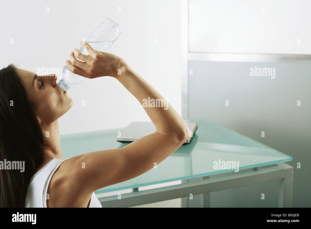 Woman quenching thirst - Stock Image