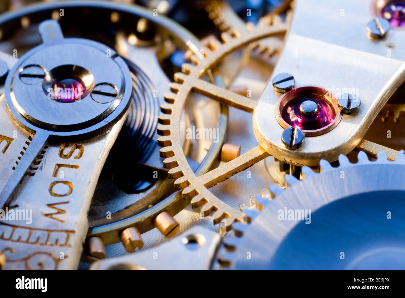 macro shot of an antique clockwork, balance wheel, stones, gearwheel, tension spring - Stock Image