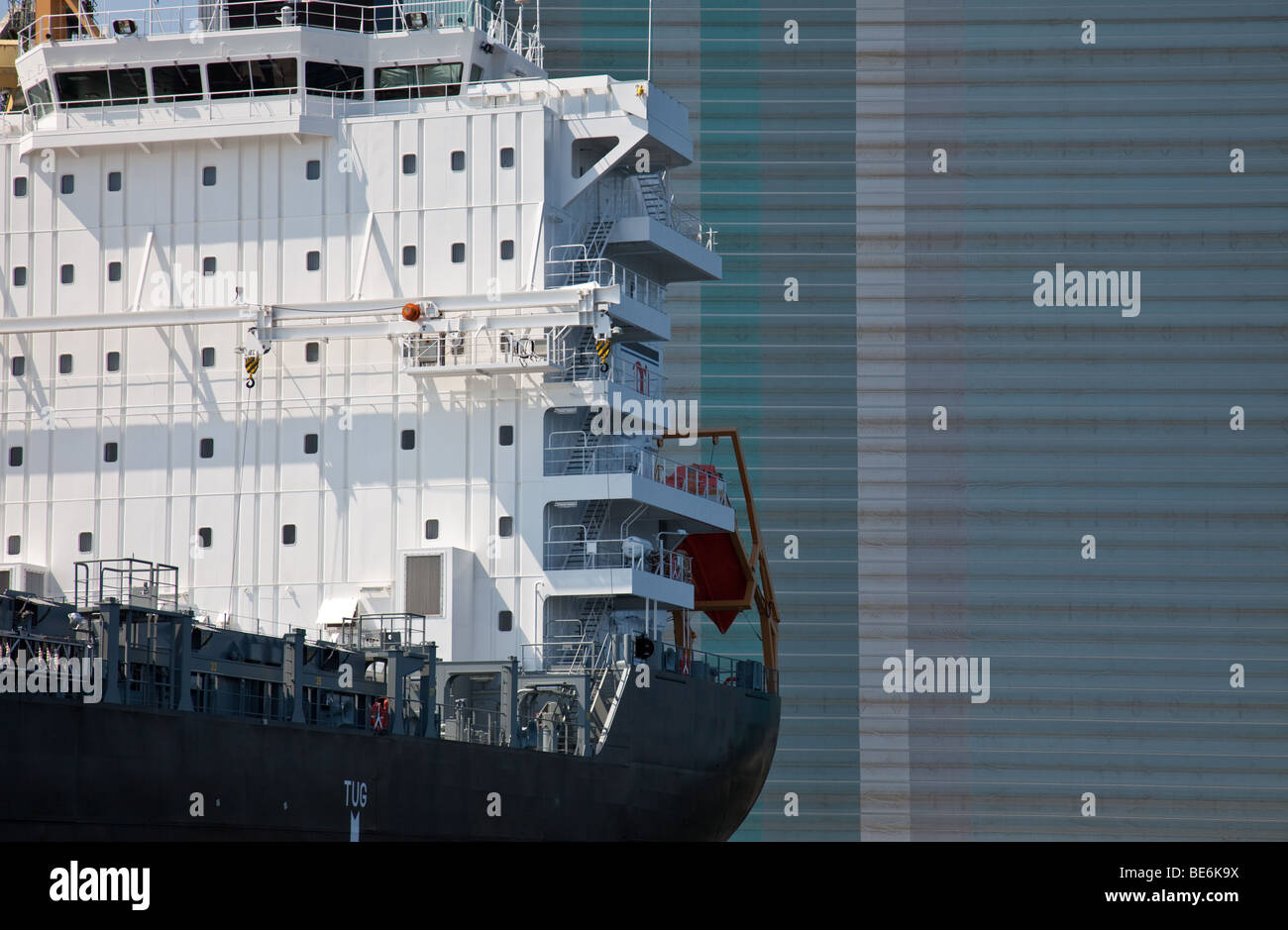 Close-up of a cargo ship in front of the shipyard in Wismar, Germany - Stock Image
