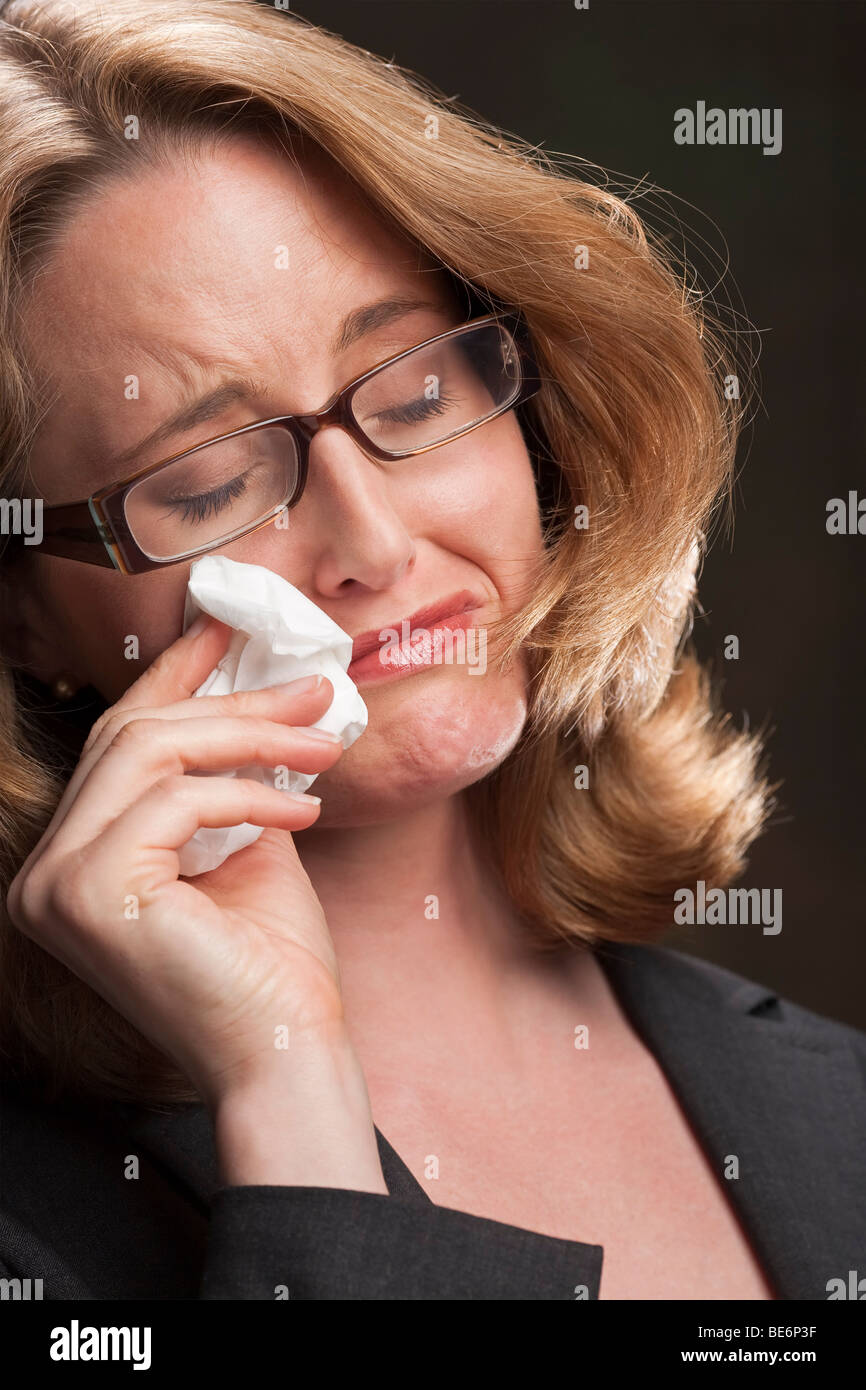 Portrait of a weeping woman crying - Stock Image