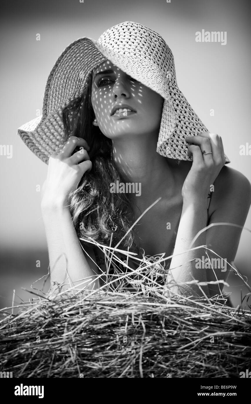 Young woman in a hat rural portrait. Black and white. - Stock Image