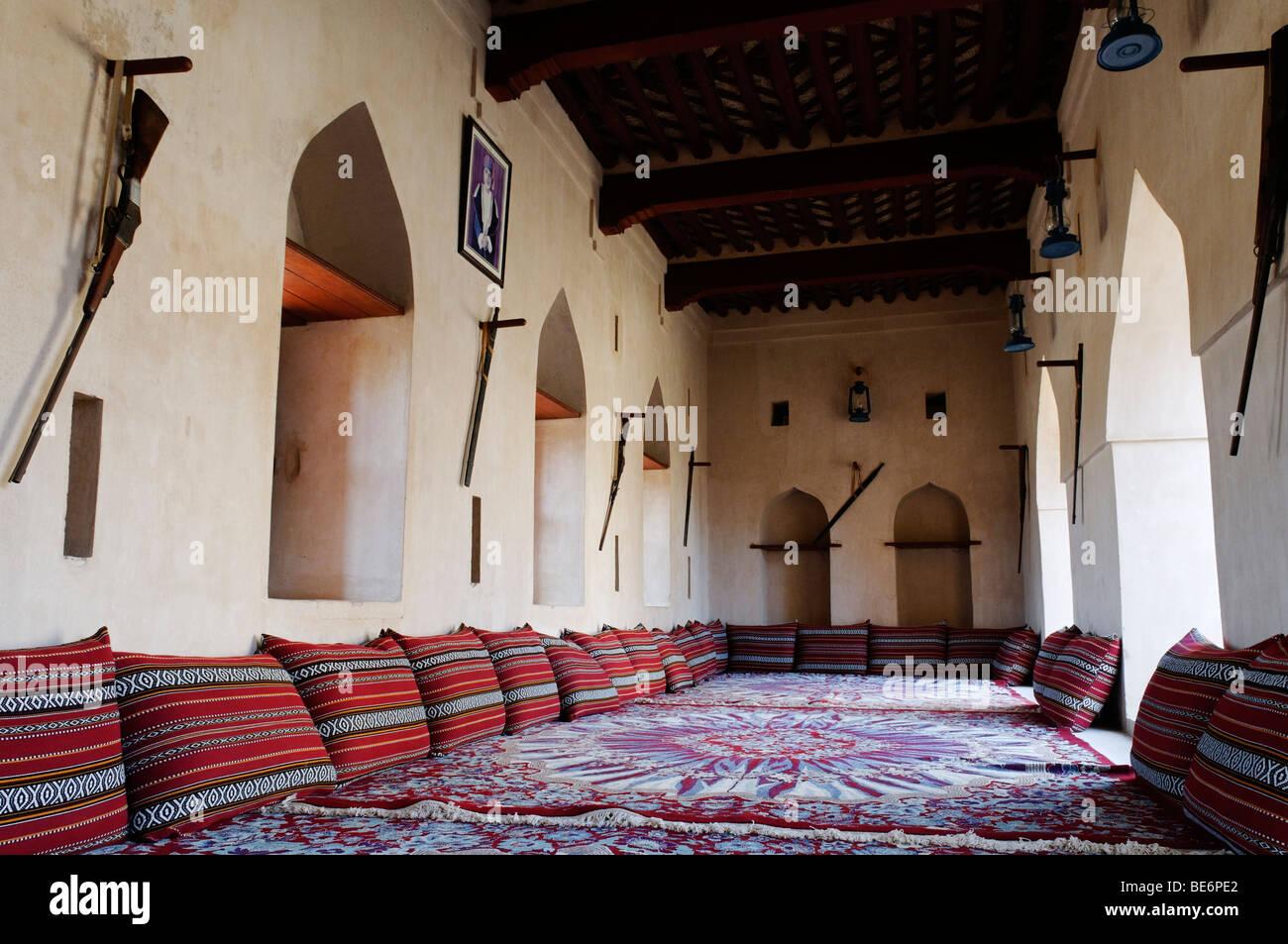 Traditional Arabian sittingroom, historic adobe fortification Jaalan Bani Bu Hasan Fort or Castle, Sharqiya Region, - Stock Image