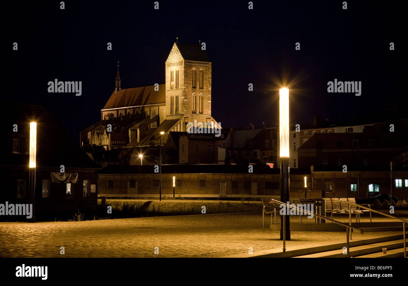 lluminated church St. Nikolai in Wismar, Germany, by night - Stock Image