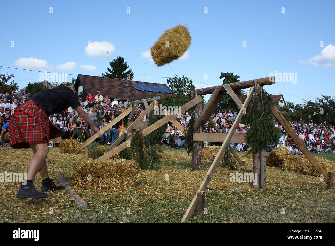 Discipline sheaf toss over an obstacle, Highland Games in Kreenheinstetten, Sigmaringen district, Upper Swabia, - Stock Image