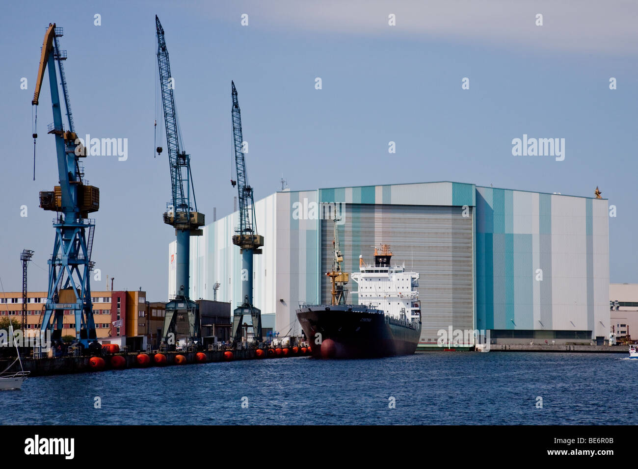 Shipyard of Wadan and freighter Cynthia in the harbor of Wismar, Germany - Stock Image