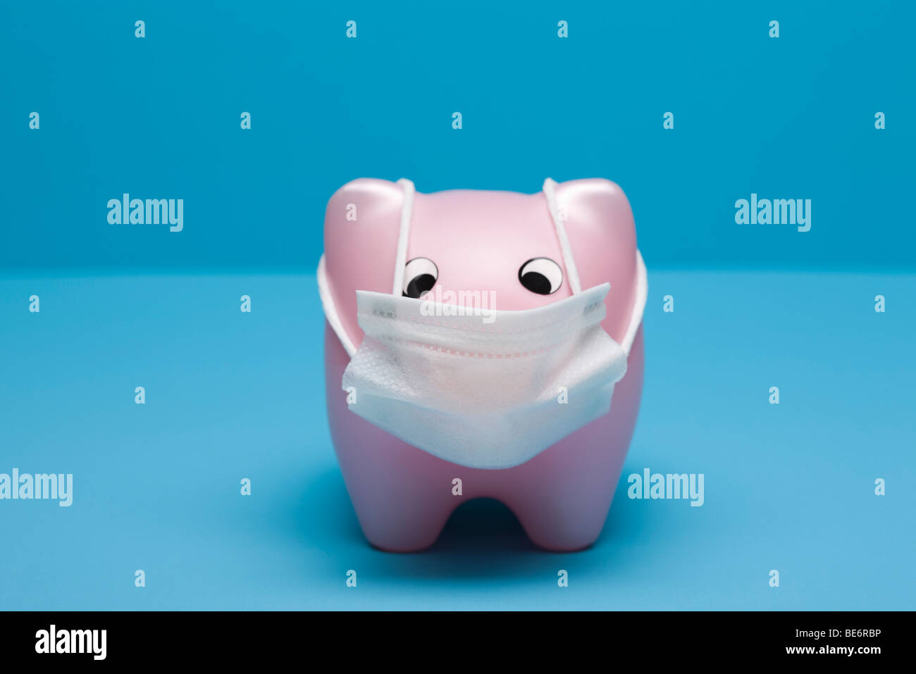 Swine flu concept, toy pig wearing flu mask - Stock Image