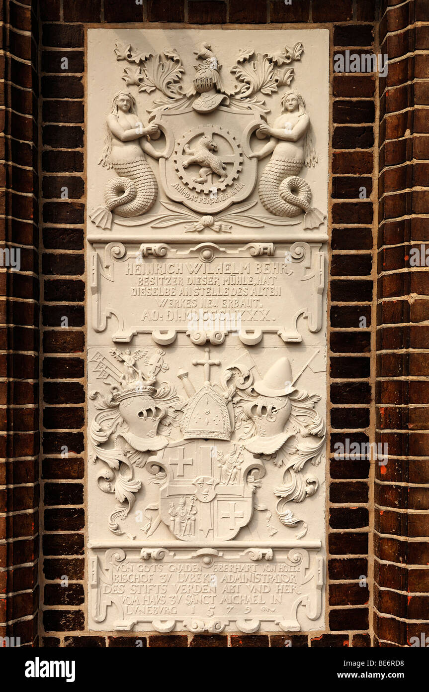 Coat of arms and a mill owner's inscription, 1880, at a water mill, Lueneburg, Lueneburg, Lower Saxony, Germany, - Stock Image