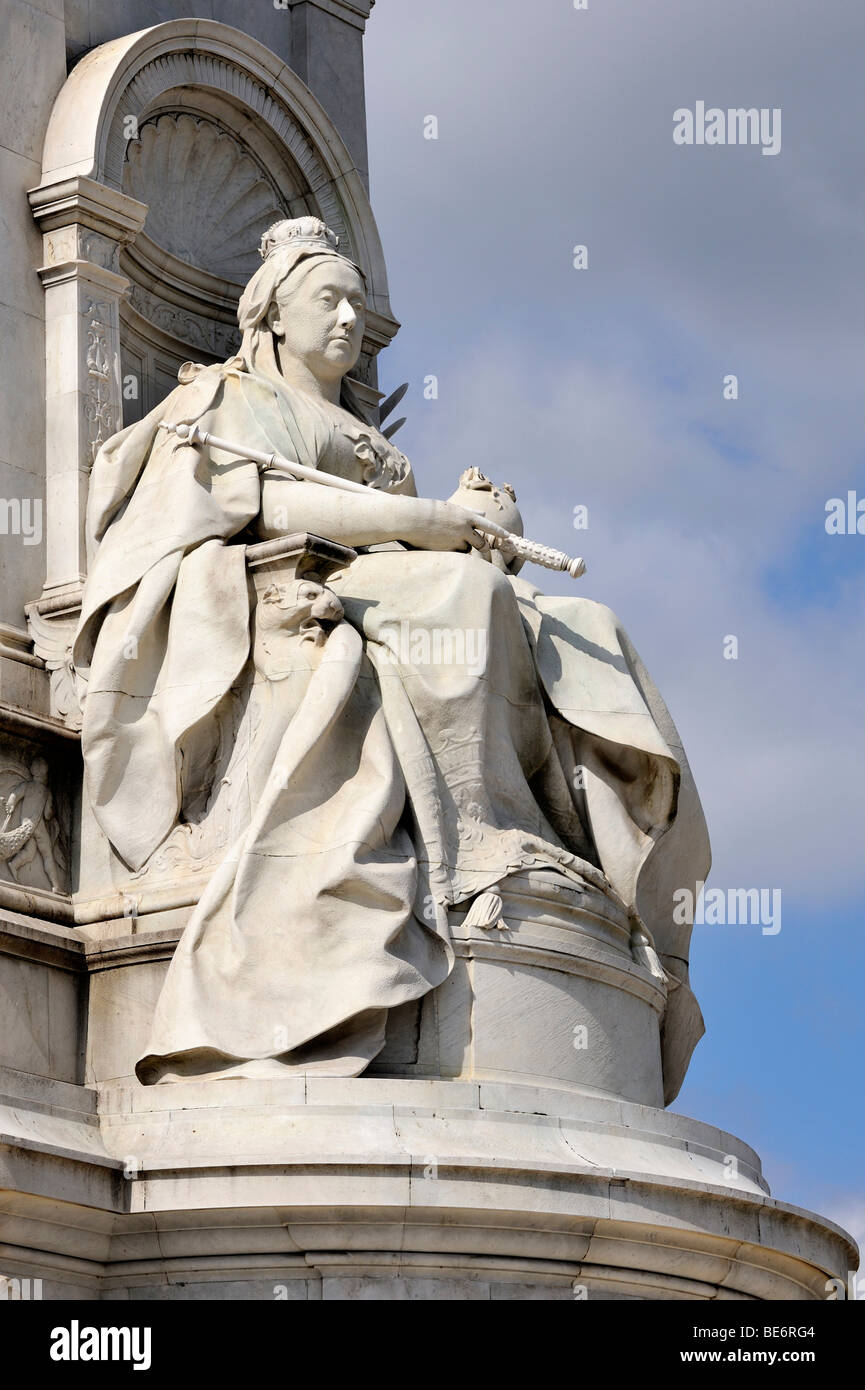 Stone statue of Queen Victoria at the Victoria Memorial at Buckingham Palace, London, England, United Kingdom, Europe - Stock Image