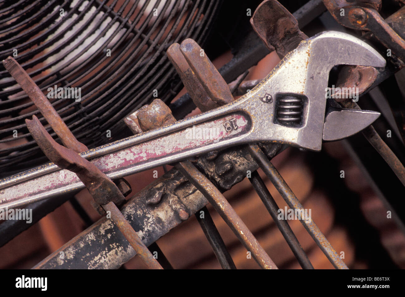 Close up of rusted metal and wrench - Stock Image