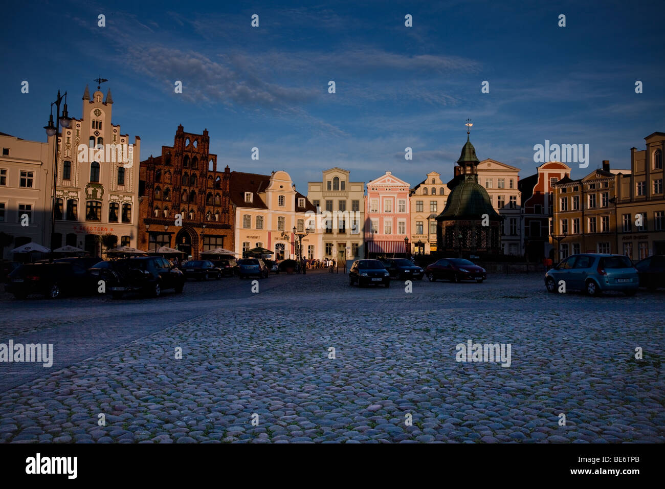Historical Houses at the old market in the centre of Wismar, Germany, at sunset - Stock Image