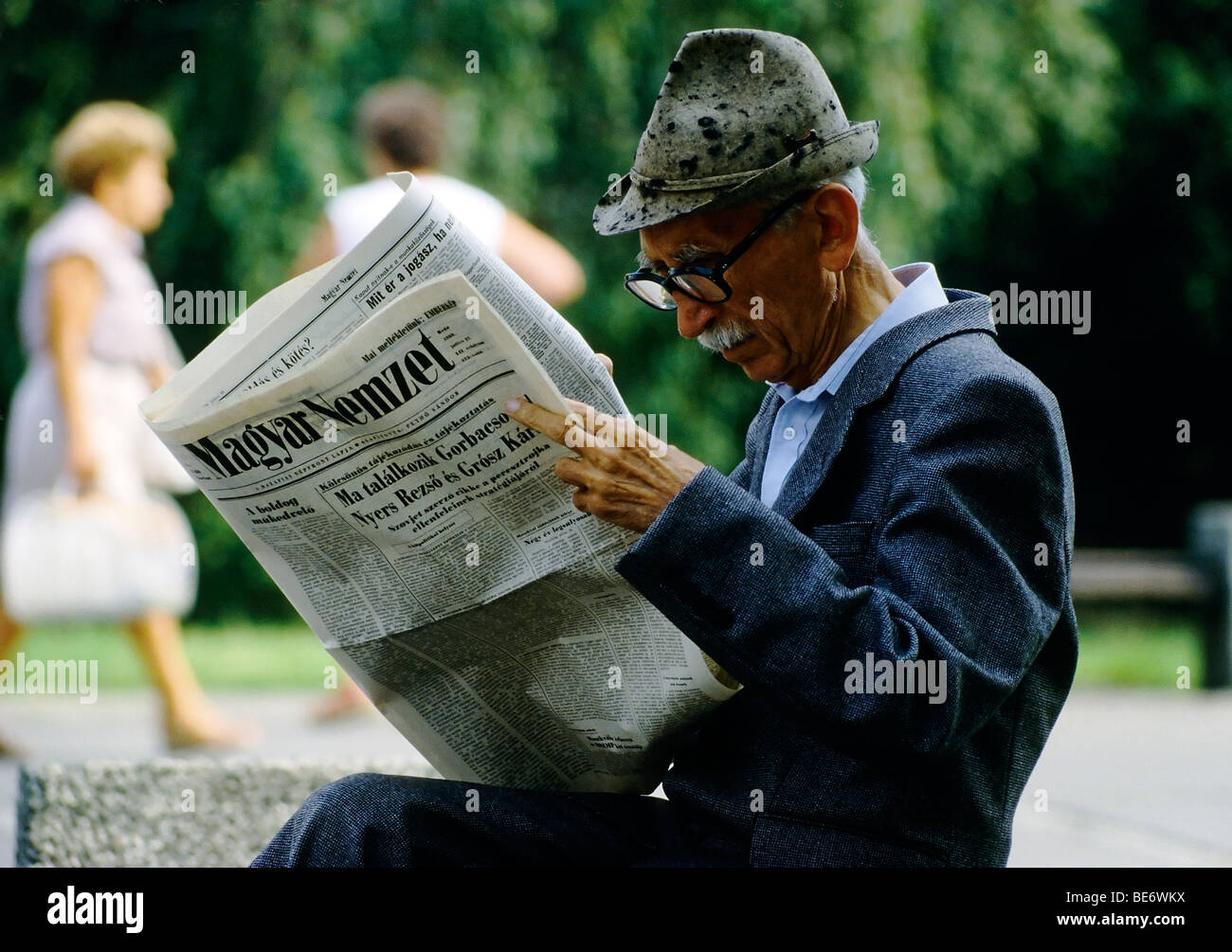 Old man reading conservative Hungarian newspaper in a park, Magyar Nemzet, Budapest, Hungary, Europe Stock Photo