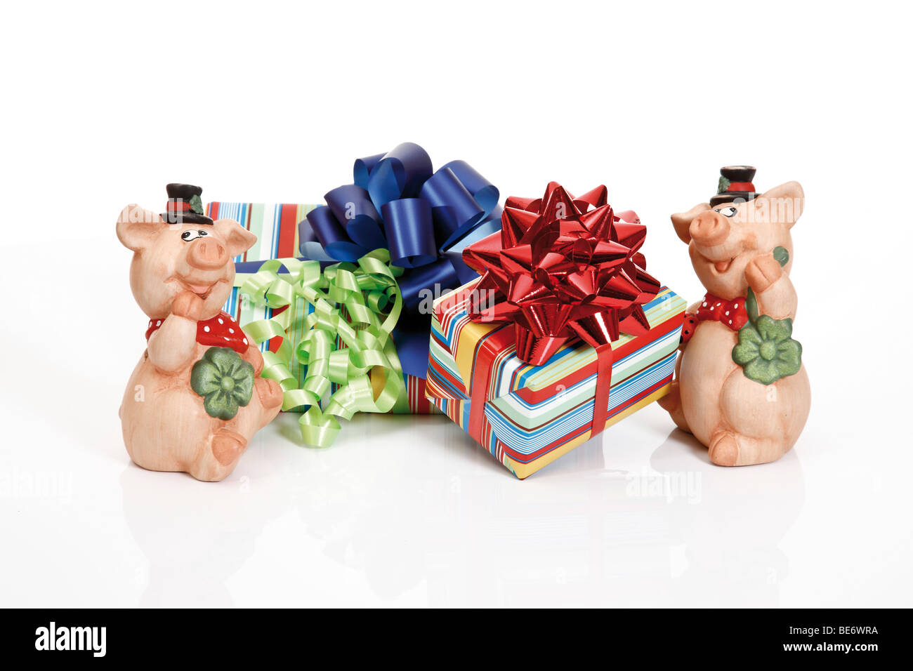 Presents with ribbons and lucky pigs - Stock Image
