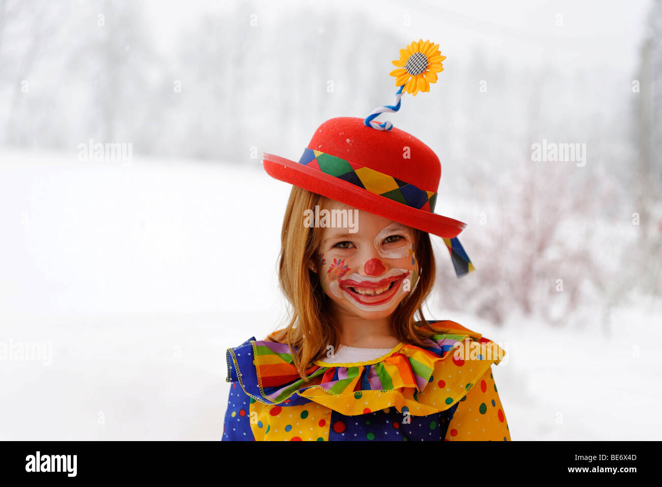 Clown girl in carnival costume Stock Photo