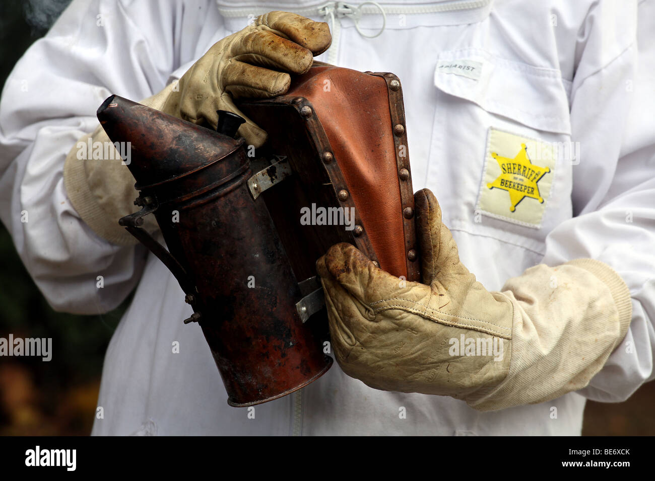 Picture by Mark Passmore. 19/09/2009. Generic picture of a Smoker held by a Beekeeper. - Stock Image
