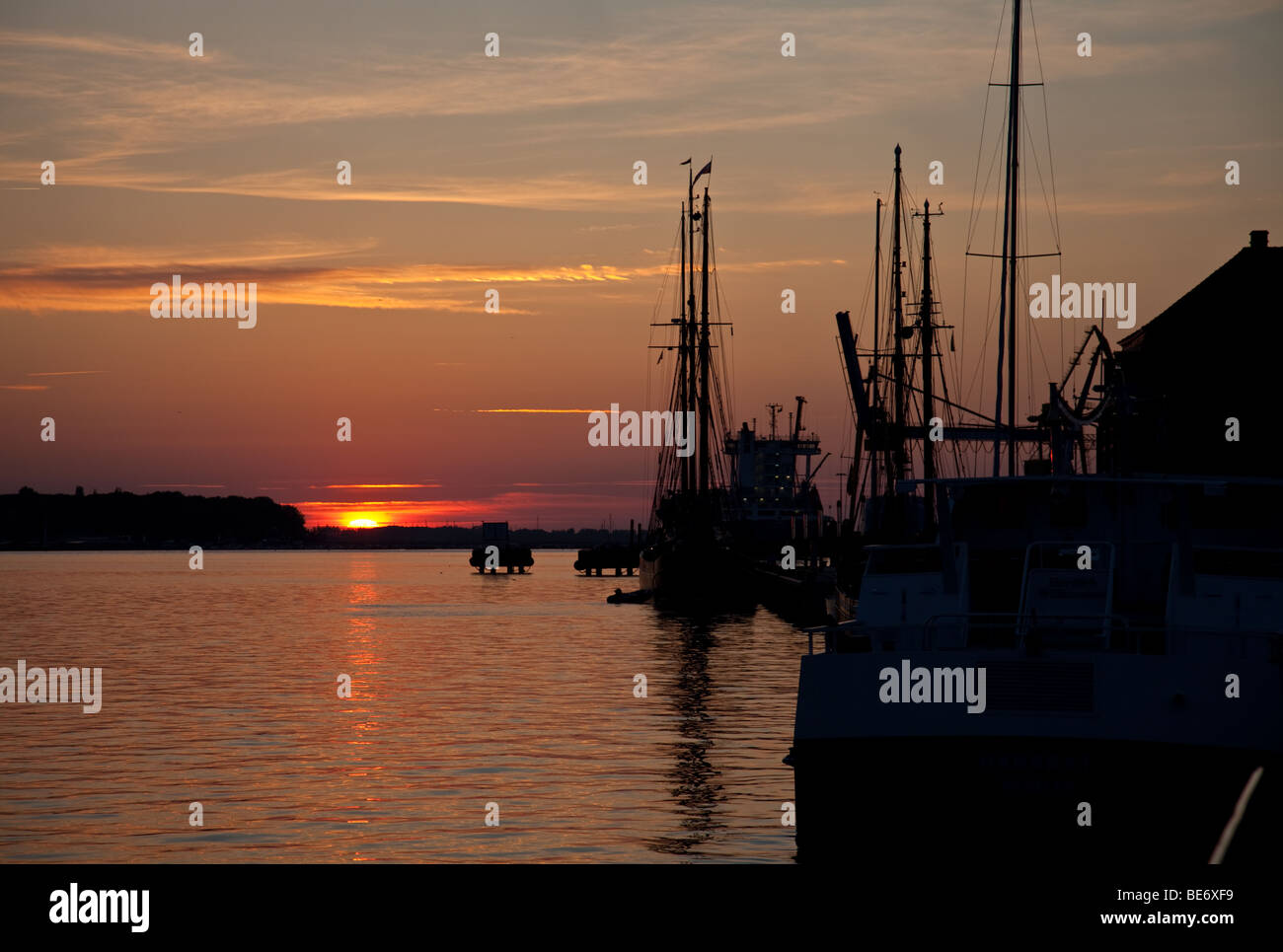Silhouettes of boats and masts at Baltic sea in Wismar, Germany - Stock Image