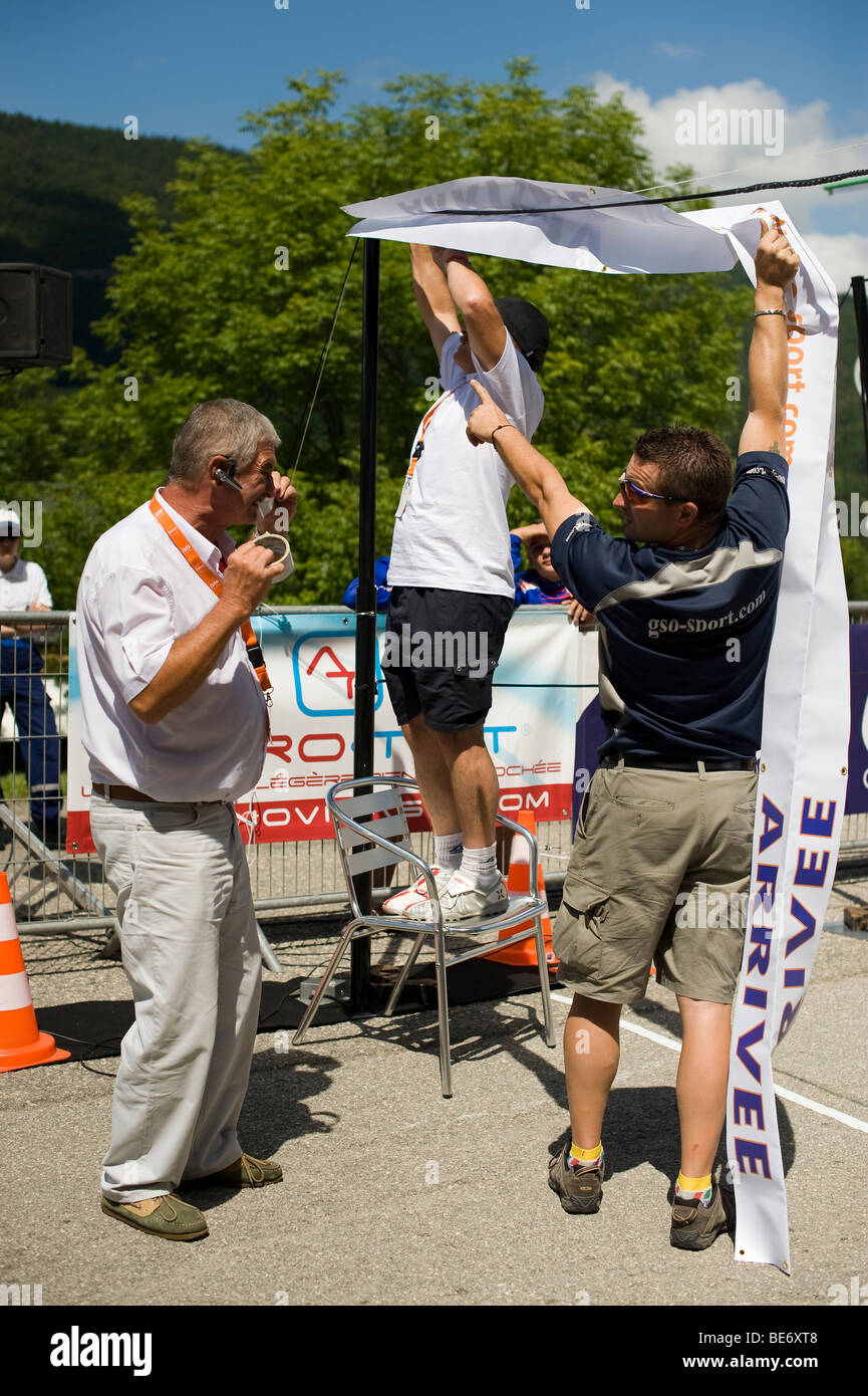 Officials setting up finish line at the tour de ain - Stock Image