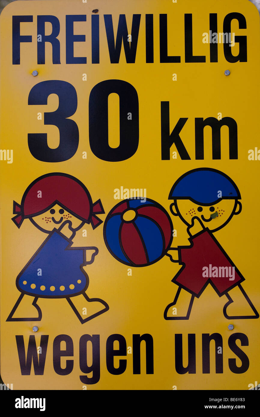 Traffic sign, drive 30 km/h for the children - Stock Image