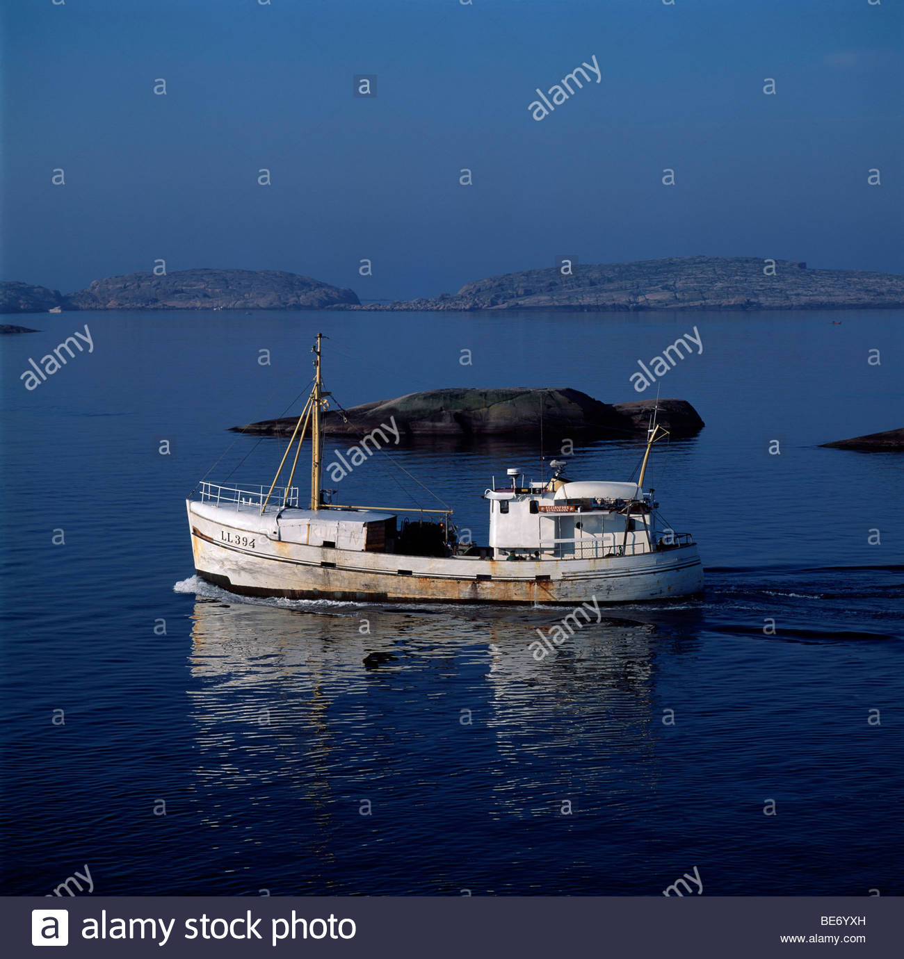 Reflection of a boat in the sea Stock Photo
