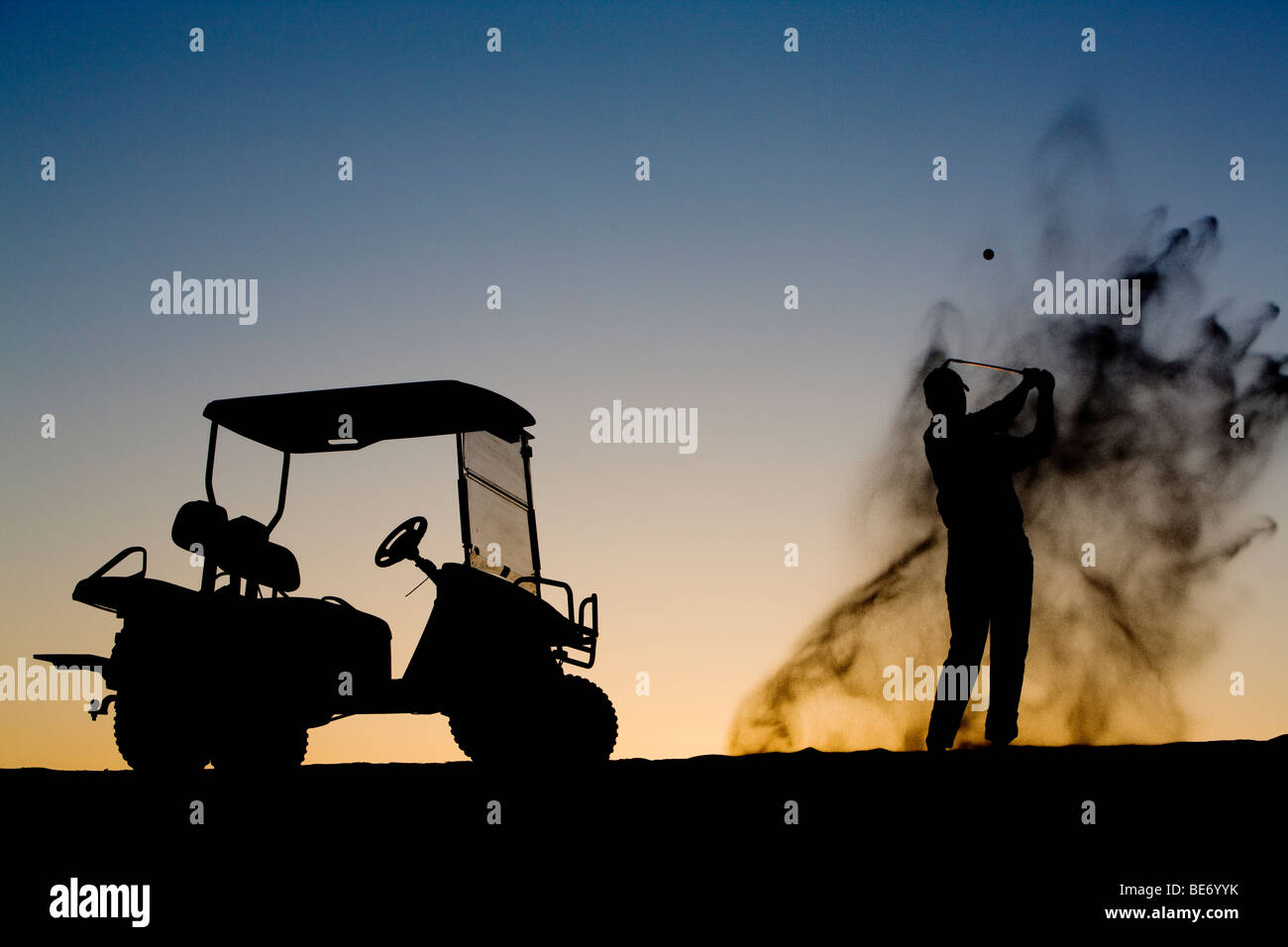 Golfing late in the day - Stock Image