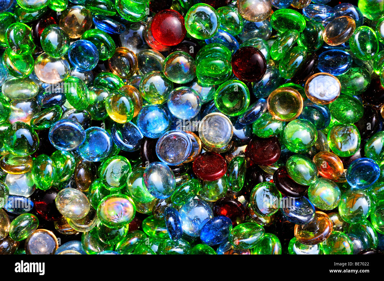 Colorful glass beads, filling the picture - Stock Image