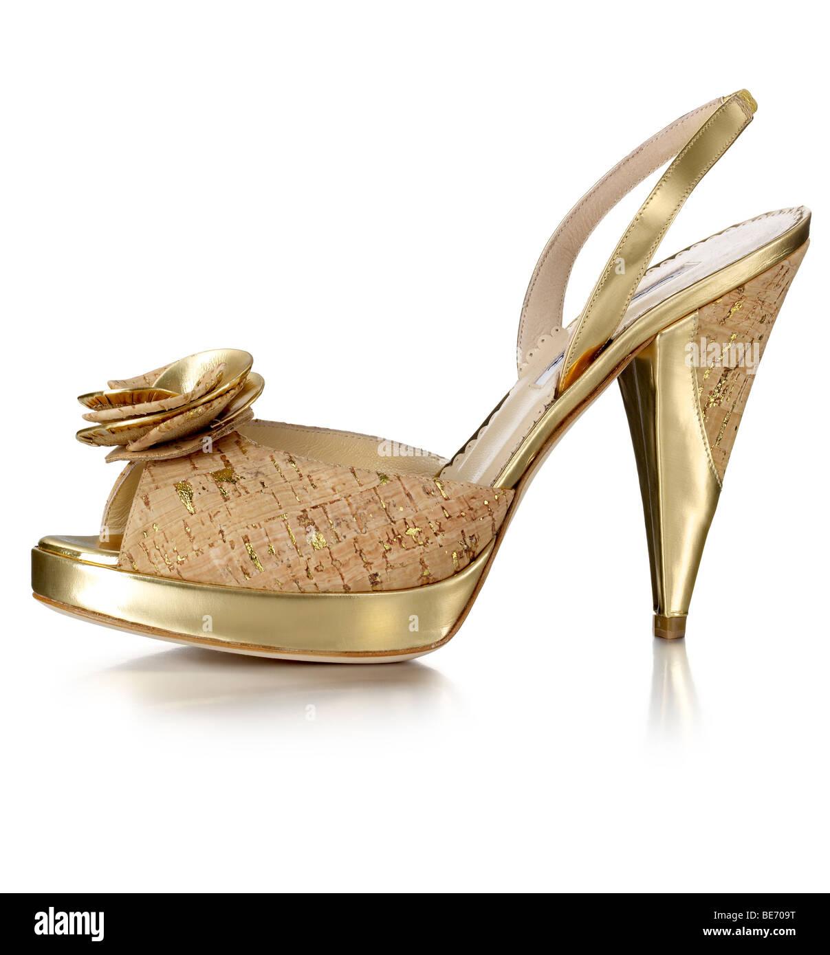 gold cork heeled sandal - Stock Image