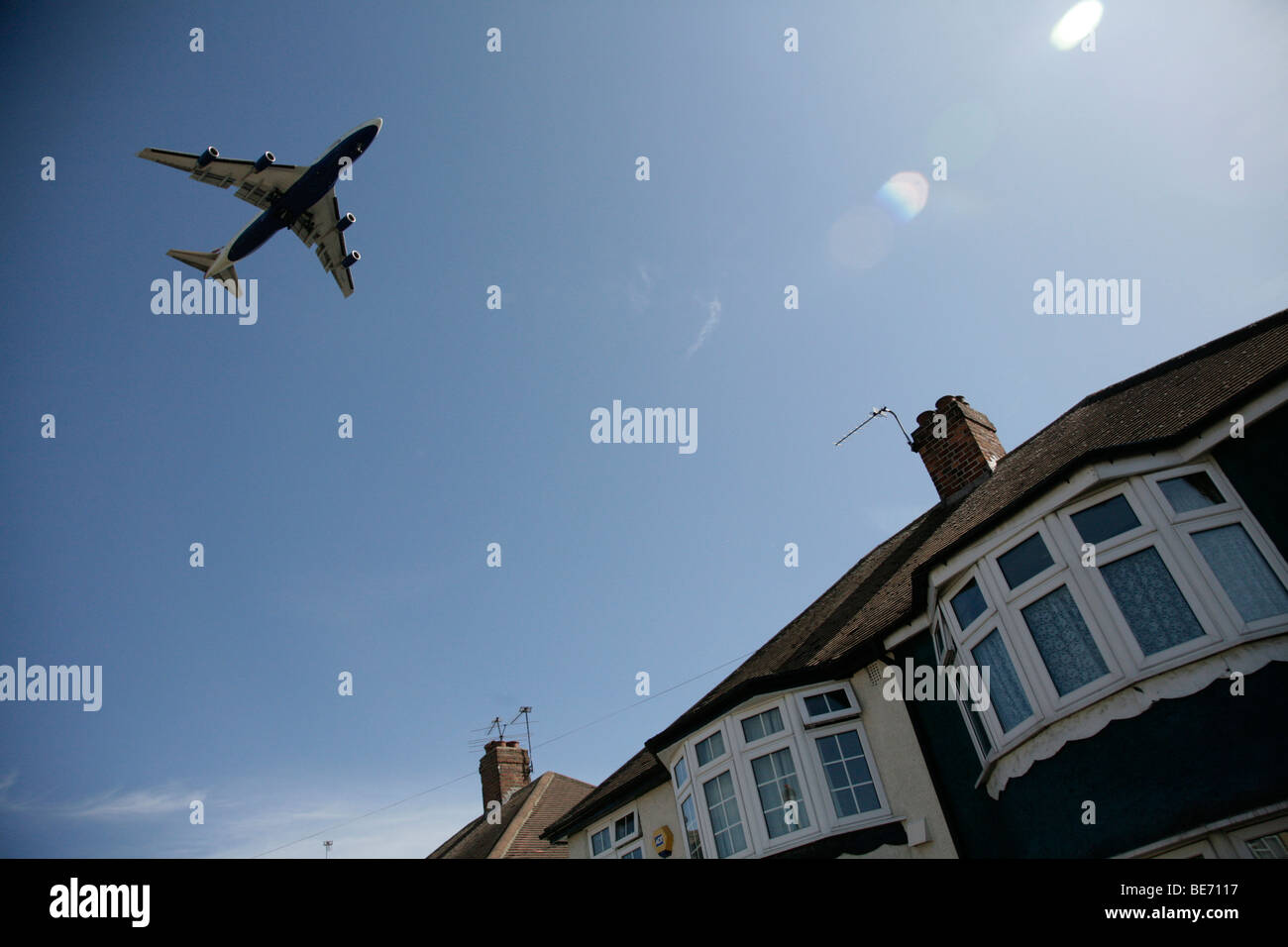 plane flying over house near heathrow airport - Stock Image