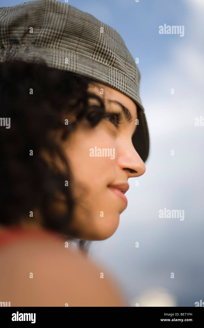 Young woman looking away dreamily, profile - Stock Image