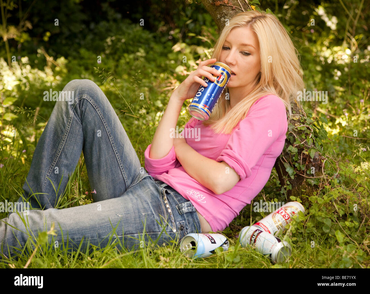 young woman drinking alcohol - Stock Image