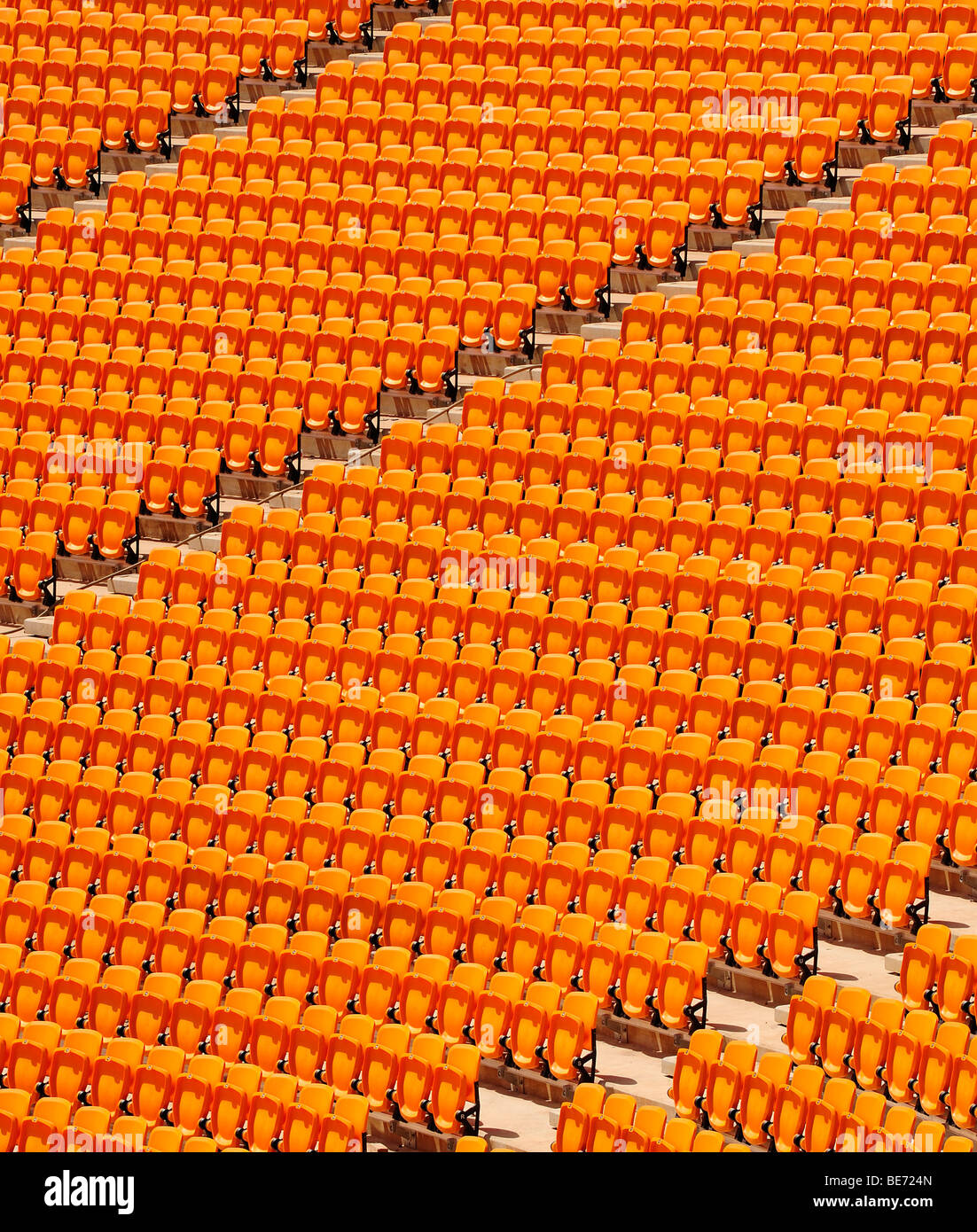 Rows of seats, grandstand, in a football stadium - Stock Image