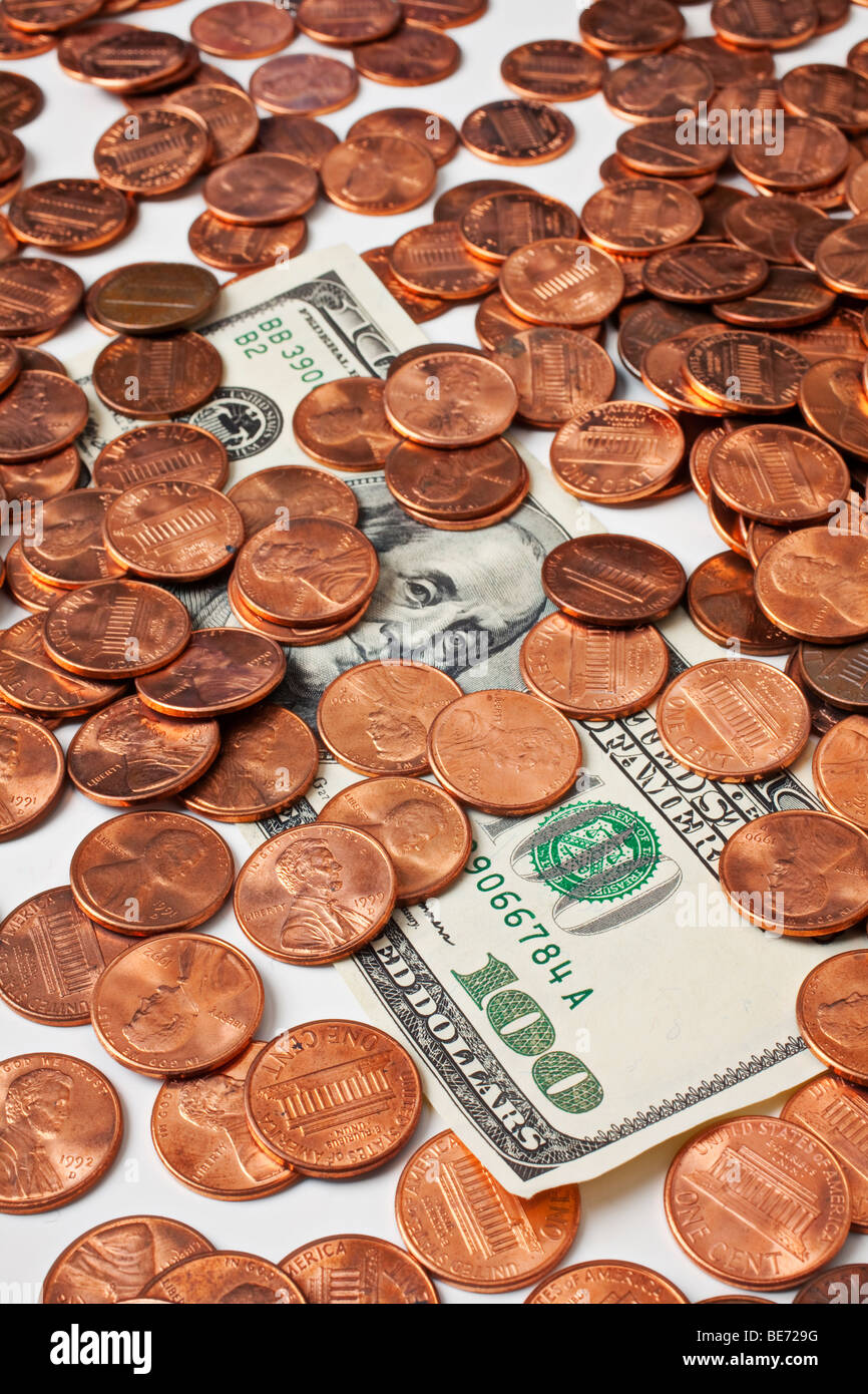 One hundred dollar bill and pennies - Stock Image