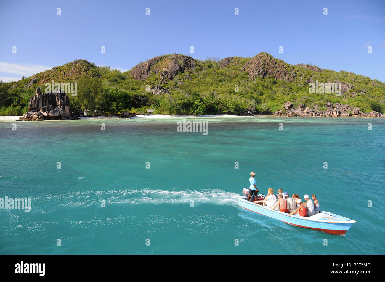 Boat with tourists, Curieuse Island, Seychelles, Africa, Indian Ocean - Stock Image