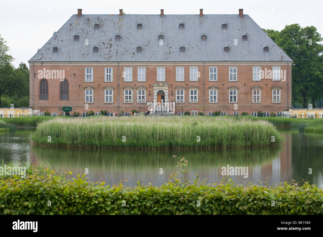 Guests arrive at  the Manor House at  Vlademars Slot. - Stock Image