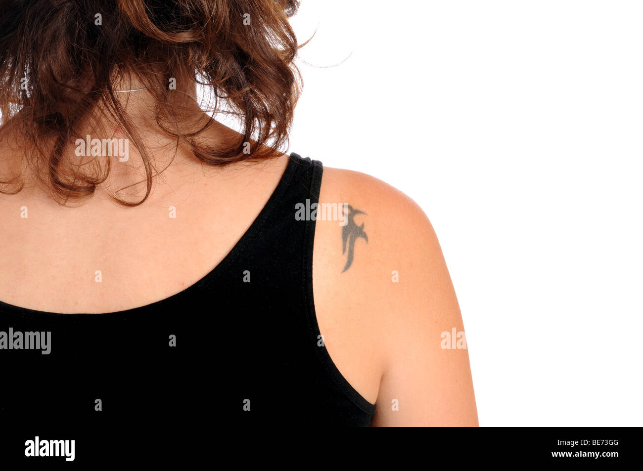 Young woman with a small tattoo in her shoulder Stock Photo