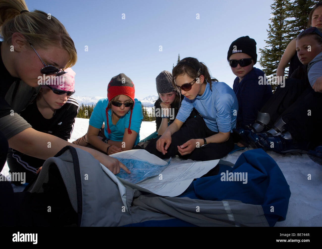 Group of young girls practising navigation with map and compass, Yukon outdoor school program, White Pass, Chilkoot - Stock Image