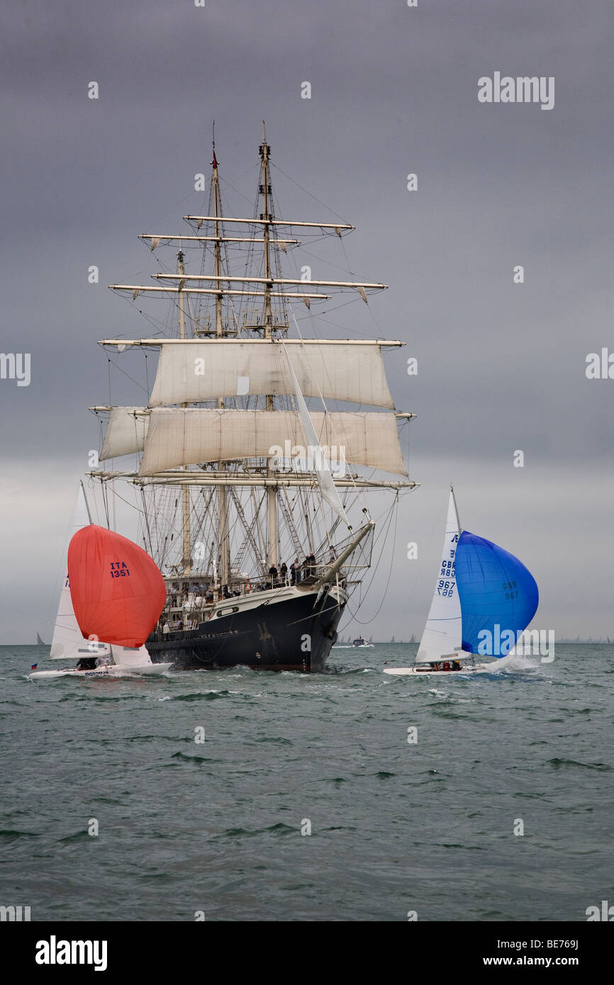 Sailing Old New Modern Big progress small fast slow square rigged spinnaker dinghy tall ship development advance - Stock Image