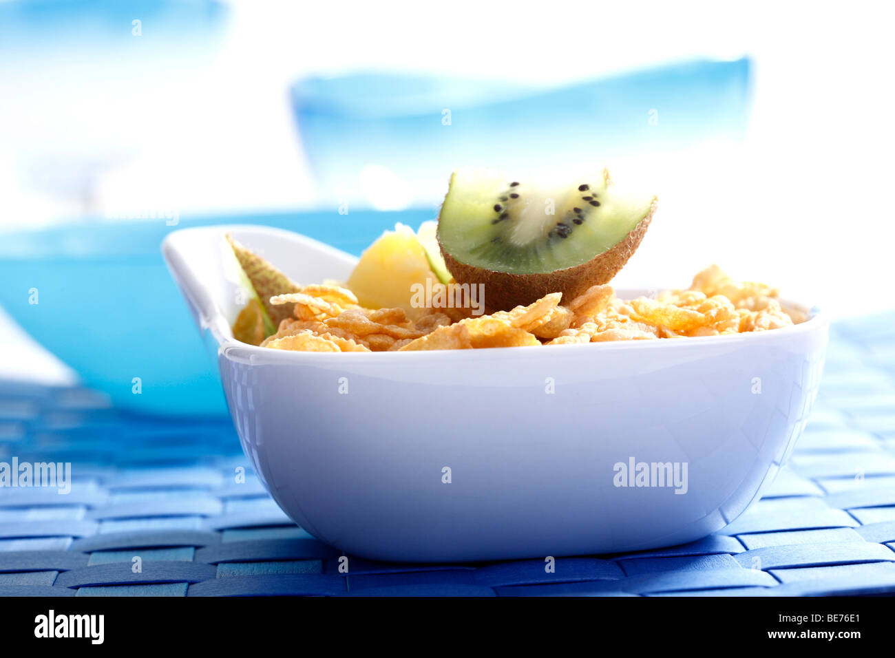 Cornflakes with kiwi and pineapple slices Stock Photo