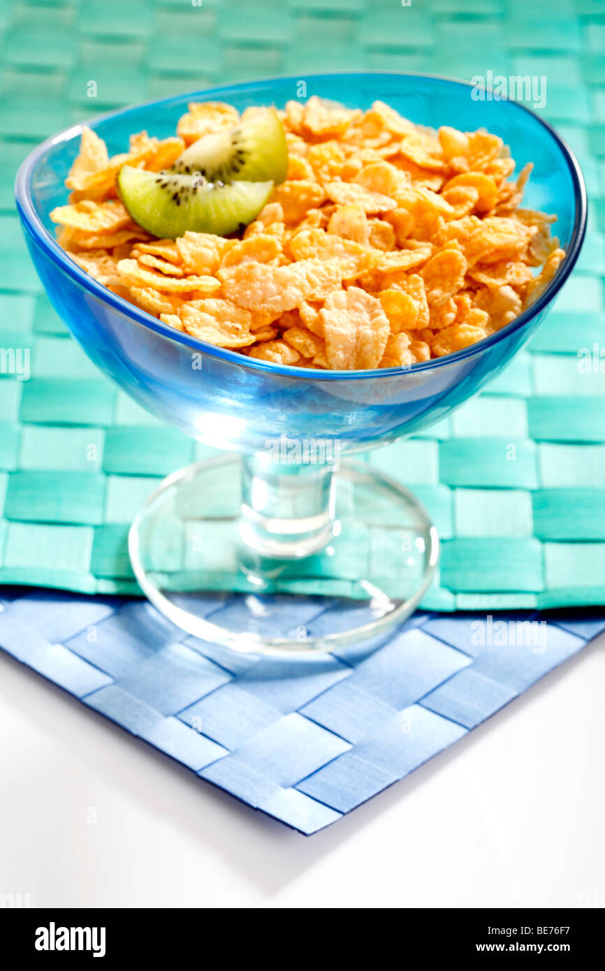 Cornflakes with kiwi slices in a bowl Stock Photo