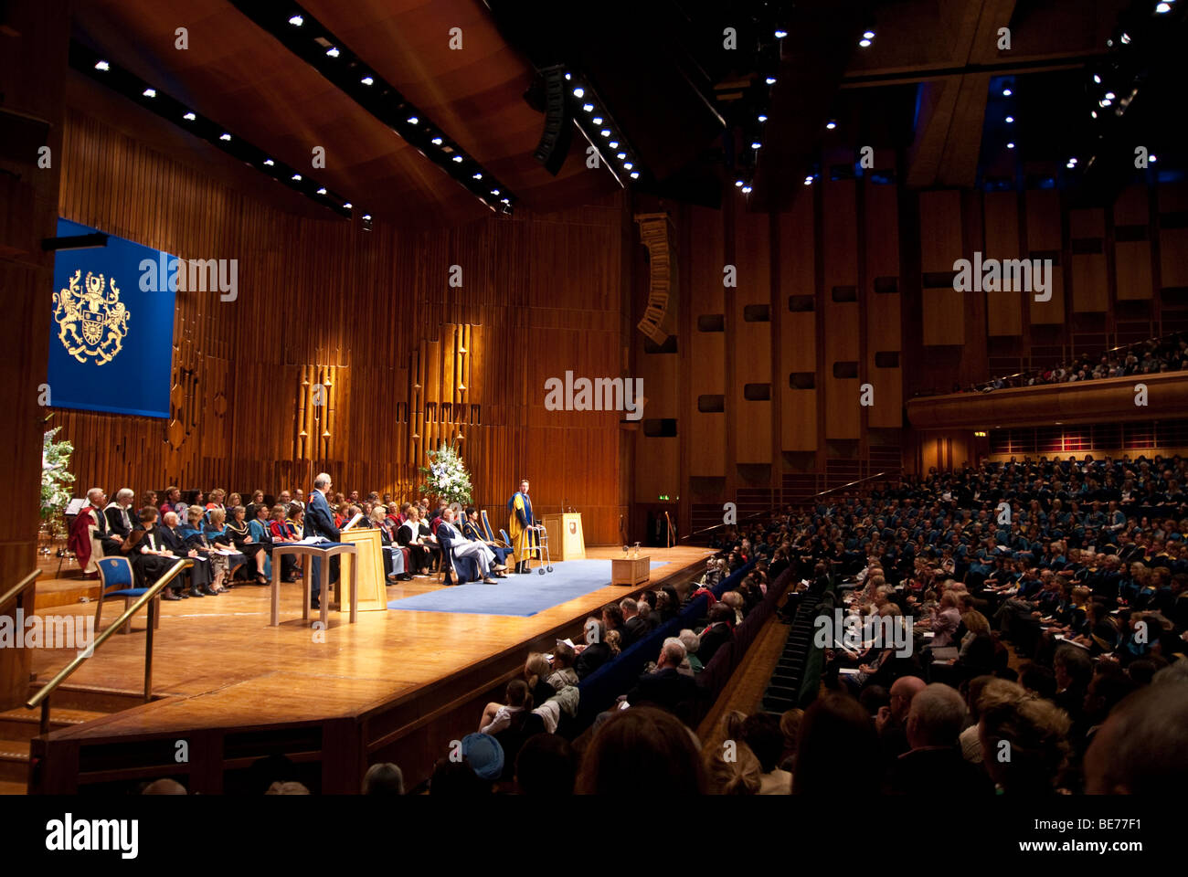 Conferment of Honorary Degree of Doctor of the Open University on Mr Frank Gardner OBE at The Barbican Centre London - Stock Image