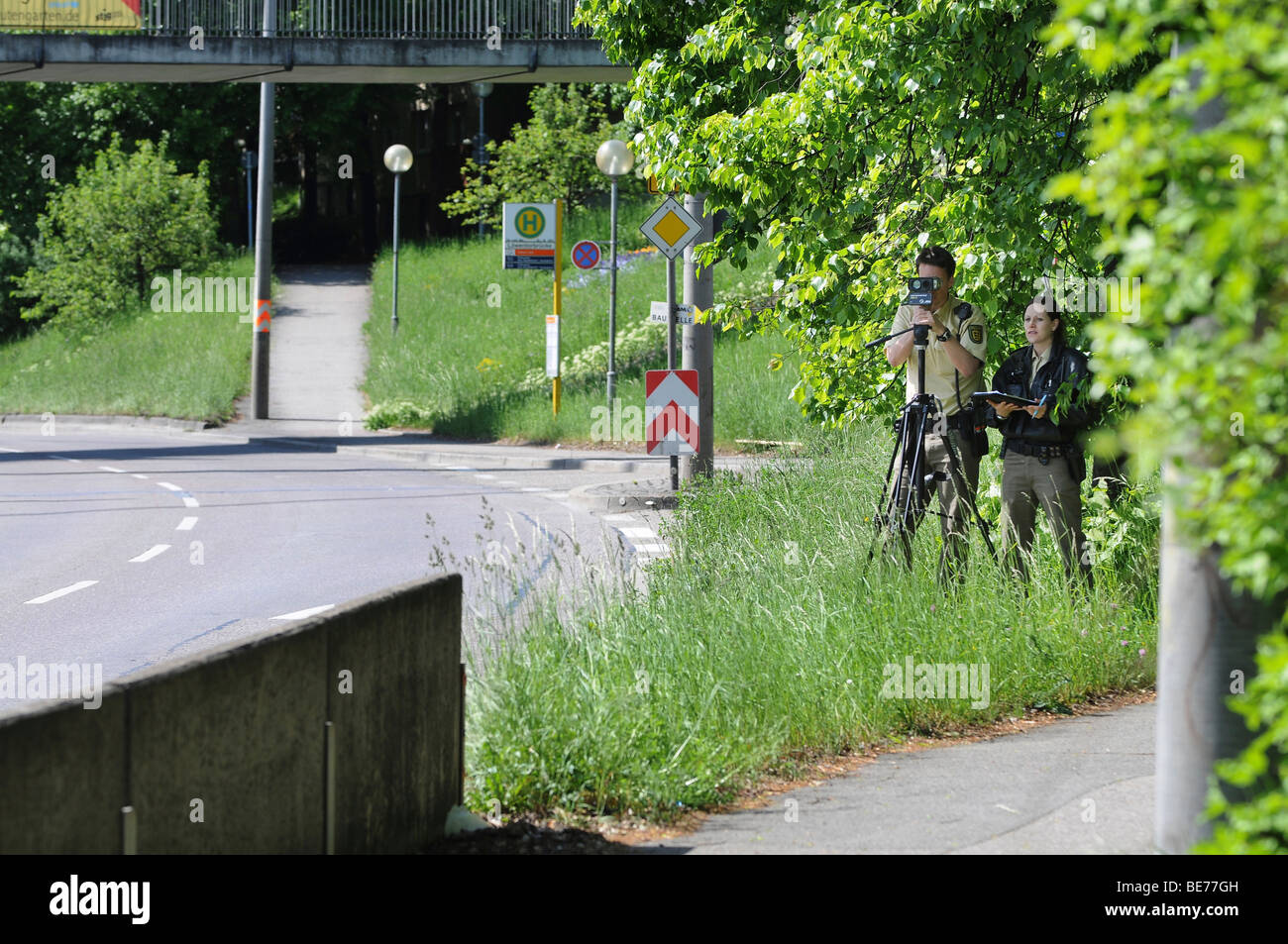 Police officers measuring speed with a laser gun, RIEGEL FG21-P, Stuttgart, Baden-Wuerttemberg, Germany, Europe Stock Photo