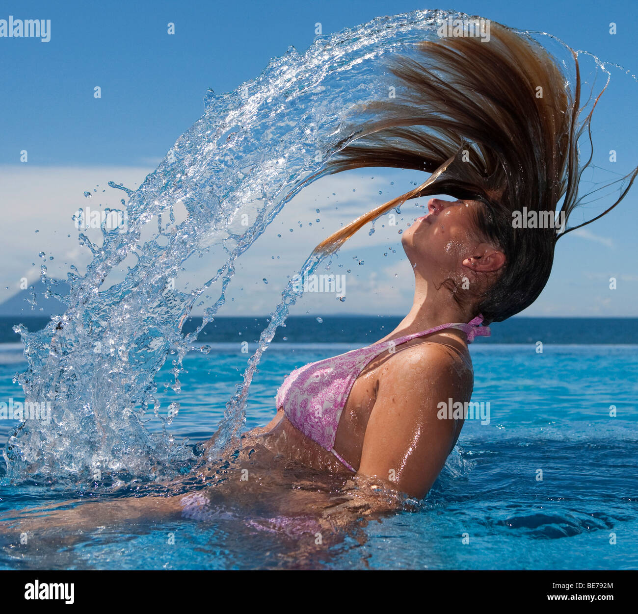 Girl playing in the pool, Indonesia, Southeast Asia - Stock Image